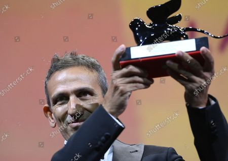"""Michelangelo Frammartino acknowledges receiving the Special Jury Prize for """"Il Buco"""" (The Hole) during the closing ceremony of the 78th annual Venice International Film Festival, in Venice, Italy, 11 September 2021. The 78th edition of the festival runs from 01 to 11 September 2021."""