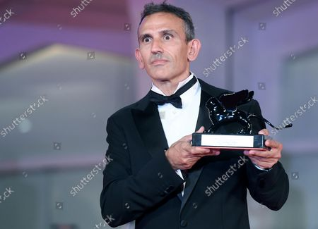 Michelangelo Frammartino holds the Special Jury Prize for his movie 'Il Buco' (The Hole) during the closing ceremony of the 78th annual Venice International Film Festival, in Venice, Italy, 11 September 2021. The 78th edition of the festival runs from 01 to 11 September 2021.