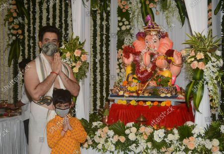 Bollywood actor Tusshar Kapoor and his son Laksshya during Ganesh Chaturthi at his Juhu bungalow, on September 10, 2021 in Mumbai, India.