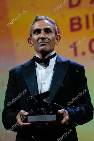 Michelangelo Frammartino holds the Special Jury Prize award for 'Il Buco' onstage at the closing ceremony during the 78th edition of the Venice Film Festival in Venice, Italy