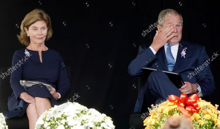 Stock Image of Former President George W. Bush, right, wipes his eyes next to former first lady Laura Bush, after he spoke at a memorial for the passengers and crew of United Flight 93, in Shanksville, Pa., on the 20th anniversary of the Sept. 11, 2001, attacks