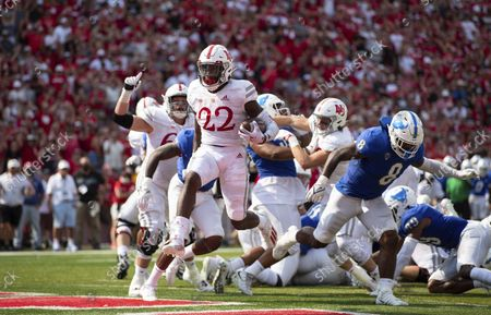Nebraska's Gabe Ervin Jr. (22) leaps into the end zone for a touchdown ahead of Buffalo's James Patterson (8) during the first half of an NCAA college football game, at Memorial Stadium in Lincoln, Neb