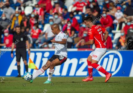 Santa Clara's Rui Costa (R) fights for the ball with Joao Mario of Benfica during their Portuguese First League soccer match held at Sao Miguel Stadium, Ponta Delgada, Sao Miguel Island, Azores, Portugal, 11 September 2021.