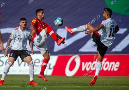 Santa Clara`s Rui Costa (C) fights for the ball with Rodrigo Pinho (R) of Benfica during their Portuguese First League soccer match held at Sao Miguel Stadium, Ponta Delgada, Sao Miguel Island, Azores, Portugal, 11 September 2021.