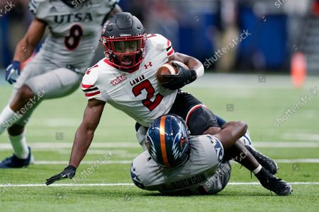 Lamar wide receiver James Jones (2) is stopped, after a catch, by UTSA cornerback Ken Robinson (21) during the first half of an NCAA college football game, in San Antonio