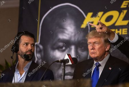 Former US President Donald J. Trump (R), with his son Donald Trump Jr. (L), attends the Former Heavyweight boxing champion Evander Holyfield against Former UFC Heavyweight World Champion Vitor Belfort 'Legends II' Heavyweight match in Hard Rock LIVE at Seminole Hard Rock Hotel and Casino in Hollywood, Florida, USA, 11 September 2021.