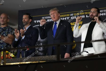 """Stock Image of Former President Donald Trump, center right, chants """"USA, USA"""" along with the crowd, after the U.S. anthem was played at a boxing event where Trump and his son, Donald Trump Jr., center left, were providing commentary, in Hollywood, Fla"""