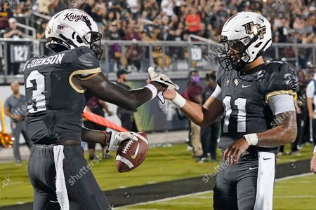 Stock Image of Central Florida wide receiver Brandon Johnson (3) celebrates his touchdown reception with quarterback Dillon Gabriel (11) during the first half of an NCAA college football game against Bethune-Cookman, in Orlando, Fla
