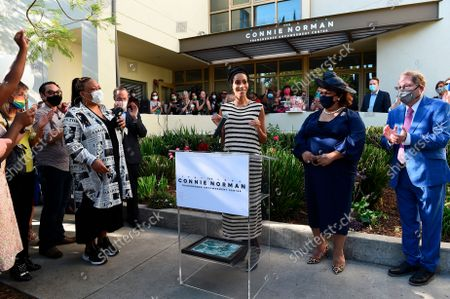 """Stock Picture of IMAGE DISTRIBUTED FOR AIDS HEALTHCARE FOUNDATION - Model, actress and activist Isis King (""""America's Next Top Model""""), addresses the crowd at the ribbon-cutting ceremony and gala celebration to open of The Connie Norman Transgender Empowerment Center, in Los Angeles, California. To her right are Queen Victoria Ortega, International President of FLUX, and Los Angeles City Councilmember Paul Koretz. The facility - believed to be the first of its kind nationwide serving Trans and Non-Binary individuals and communities and run of, by and for Trans and Non-Binary individuals - is named in honor of Connie Norman, known as the 'AIDS Diva,' a fearless Transgender rights and AIDS activist who died of the disease in 1996"""
