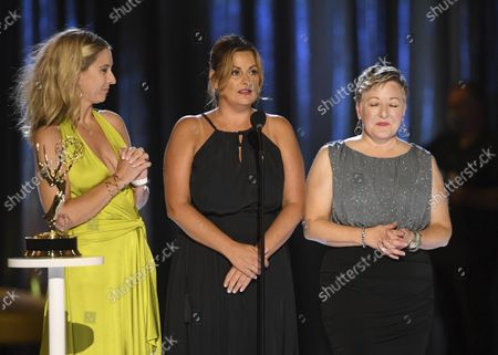 """Cara Hannah, from left, Jodi Mancuso, and Inga Thrasher accept the award for outstanding contemporary hairstyling for a variety, nonfiction or reality program for """"Saturday Night Live"""" hosted by Maya Rudolph during night one of the Television Academy's 2021 Creative Arts Emmy Awards at the L.A. LIVE Event Deck, in Los Angeles"""