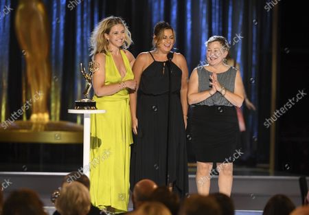 """Stock Photo of Cara Hannah, from left, Jodi Mancuso, and Inga Thrasher accept the award for outstanding contemporary hairstyling for a variety, nonfiction or reality program for """"Saturday Night Live"""" hosted by Maya Rudolph during night one of the Television Academy's 2021 Creative Arts Emmy Awards at the L.A. LIVE Event Deck, in Los Angeles"""