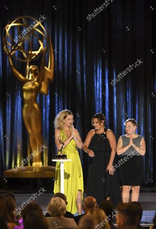 """Stock Image of Cara Hannah, from left, Jodi Mancuso, and Inga Thrasher accept the award for outstanding contemporary hairstyling for a variety, nonfiction or reality program for """"Saturday Night Live"""" hosted by Maya Rudolph during night one of the Television Academy's 2021 Creative Arts Emmy Awards at the L.A. LIVE Event Deck, in Los Angeles"""