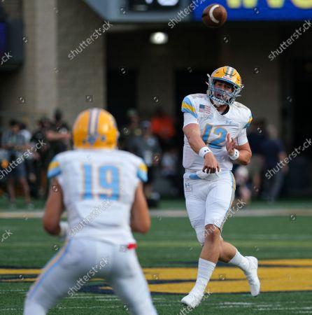 Long Island quarterback Camden Orth (12) throws the ball to Long Island receiver Steven Chambers (19). West Virginia University defeated Long Island University 66-0 at Mountaineer Field at Milan Puskar Stadium in Morgantown, West Virginia