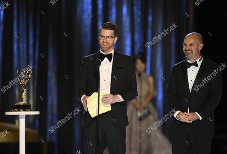 Sean Byrne, left, and Ryan Kennedy accept the award for Outstanding Sound Mixing for a Comedy or Drama Series (Half-Hour) and Animation during night one of the Television Academy's 2021 Creative Arts Emmy Awards at the L.A. LIVE Event Deck, in Los Angeles