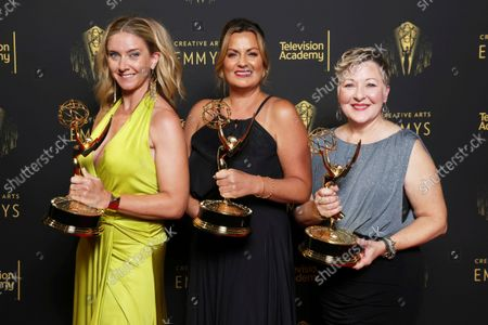 """Cara Hannah, Jodi Mancuso, and Inga Thrasher pose for a portrait with their awards for outstanding contemporary hairstyling for a variety, nonfiction or reality program for """"Saturday Night Live"""" hosted by Maya Rudolph, during night one of the Television Academy's 2021 Creative Arts Emmy Awards at the L.A. LIVE Event Deck, in Los Angeles"""