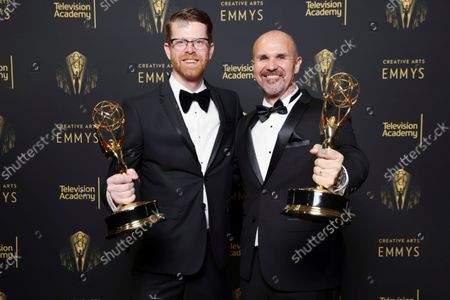Sean Byrne and Ryan Kennedy pose for a portrait with their awards for Outstanding Sound Mixing for a Comedy or Drama Series (Half-Hour) and Animation at the Media Center during night one of the Television Academy's 2021 Creative Arts Emmy Awards at the L.A. LIVE Event Deck, in Los Angeles