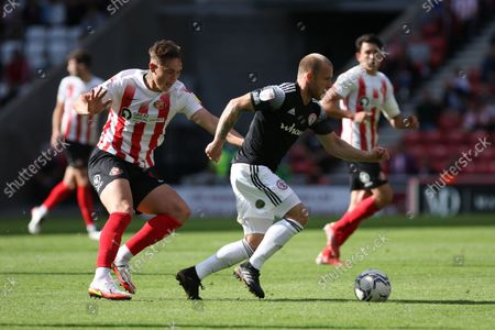 Stock Photo of Callum Doyle of Sunderland and David Morgan of Accrington Stanley in action during the Sky Bet League 1 match between Sunderland and Accrington Stanley at the Stadium Of Light, Sunderland on Saturday 11th September 2021.
