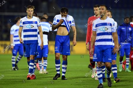 PEC Zwolle players walk off the field disappointed during the Dutch Eredivisie match between PEC Zwolle and Ajax at the MAC3Park stadium on September 11, 2021 in Zwolle, the Netherlands.