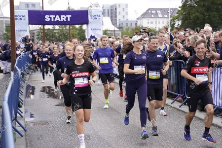 Stock Picture of Mary, Crown Princess of Denmark (C, wearing a cap) runs 5 km during the Royal Run in Aalborg, Denmark, 12 September 2021.
