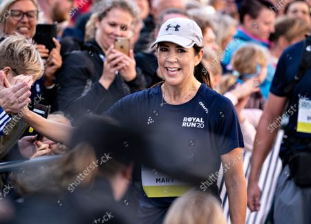 Stock Photo of Crown Princess Mary of Denmark (C) arrives in the finish area as she runs 5 km during the Royal Run in Aalborg, Denmark, 12 September 2021.