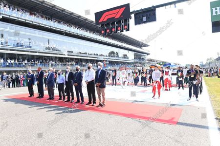 Chase Carey, Non executive Chairman, Formula 1, Jean Todt, President, FIA, Ross Brawn, Managing Director of Motorsports, and dignitaries stand with the drivers and Italian Olympic and Footballing heroes on the grid prior to the start during the 2021 Formula One Italian Grand Prix