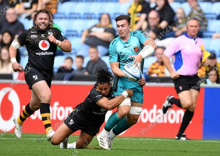 Stock Picture of Taine Basham of Dragons is tackled by Marcus Watson of Wasps.