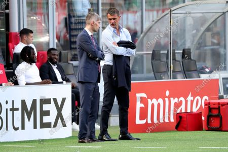 Federico Massara (L) AC Milan Director of Sport and Paolo Maldini (R) AC Milan First Team Technical Director talk during the Serie A match between AC Milan and SS Lazio at Stadio Giuseppe Meazza on September 12, 2021 in Milan, Italy.