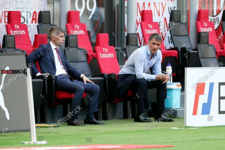 Federico Massara (L) AC Milan Director of Sport and Paolo Maldini (R) AC Milan First Team Technical Director attend during the Serie A match between AC Milan and SS Lazio at Stadio Giuseppe Meazza on September 12, 2021 in Milan, Italy.