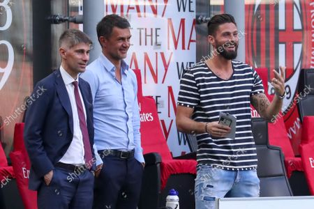 Federico Massara (L) AC Milan Director of Sport, Paolo Maldini (C) AC Milan First Team Technical Director and Olivier Giroud (R) talk during the Serie A match between AC Milan and SS Lazio at Stadio Giuseppe Meazza on September 12, 2021 in Milan, Italy.
