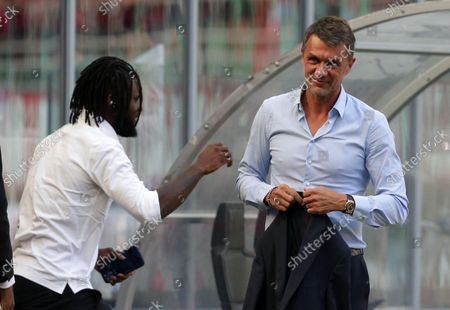 AC Milan's technical director Paolo Maldini  R) and AC Milan's midfielder Frank Kessie before the Italian Serie A soccer match AC Milan vs SS Lazio at the Giuseppe Meazza Stadium in Milan, Italy, 12 September 2021.