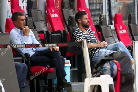 AC Milan's technical director Paolo Maldini (L) and AC Milan's forward Oliver Giroud before the Italian Serie A soccer match AC Milan vs SS Lazio at the Giuseppe Meazza Stadium in Milan, Italy, 12 September 2021.