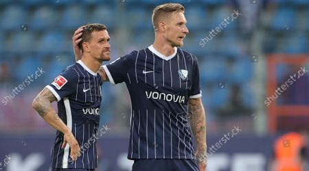 Bochum players Simon Zoller (L) and Sebastian Polter (R) react after the German Bundesliga soccer match between VfL Bochum and Hertha BSC in Bochum, Germany, 12 September 2021.