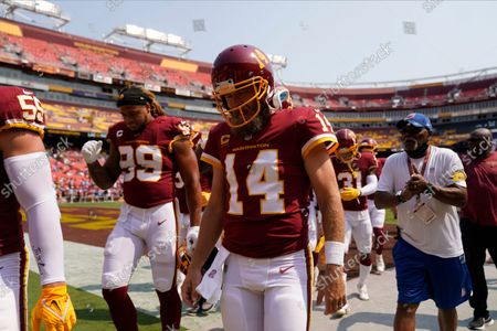 Washington Football Team quarterback Ryan Fitzpatrick (14) walking back to the lockerroom prior to the start of the first half of an NFL football game against the Los Angeles Chargers, in Landover, Md