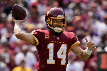 Washington Football Team quarterback Ryan Fitzpatrick (14) throws the ball against the Los Angeles Chargers during the first half of an NFL football game, in Landover, Md