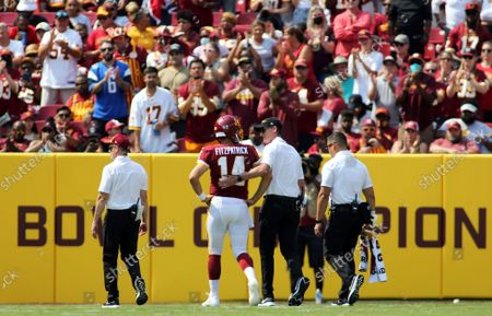 Washington Football Team quarterback Ryan Fitzpatrick (14) gets injured and receives a standing ovation during an NFL football game against the Los Angeles Chargers, in Landover, Md