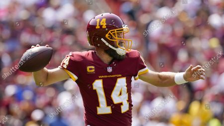Washington Football Team quarterback Ryan Fitzpatrick (14) throws the ball during the first half of an NFL football game, in Landover, Md