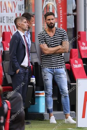 Olivier Giroud of AC Milan talks to Paolo Maldini Technical Area Director of AC Milan and Frederic Massara Sport Director of AC Milan