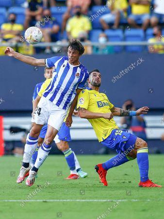 Alvaro Negredo of Cadiz CF and Robin Le Normand of Real Sociedad