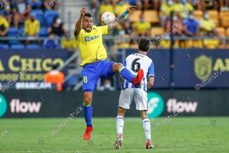 Alvaro Negredo of Cadiz CF and Aritz Elustondo of Real Sociedad