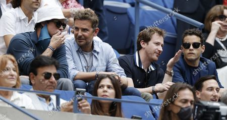 US actors Bradley Cooper (2L) and Rami Malek (R) watch as Novak Djokovic of Serbia plays Daniil Medvedev of Russia during their men's final match on the fourteenth day of the US Open Tennis Championships at the USTA National Tennis Center in Flushing Meadows, New York, USA, 12 September 2021. The US Open runs from 30 August through 12 September.