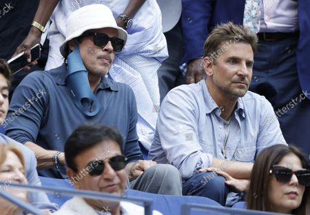US actors Brad Pitt (L) and Bradley Cooper (R) watch as Novak Djokovic of Serbia plays Daniil Medvedev of Russia during their men's final match on the fourteenth day of the US Open Tennis Championships at the USTA National Tennis Center in Flushing Meadows, New York, USA, 12 September 2021. The US Open runs from 30 August through 12 September.