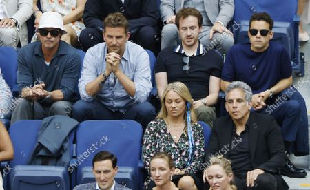 US actors Brad Pitt (L),  Bradley Cooper (2L), Rami Malek (R), Christine Taylor (F-L) and Ben Stiller (F-R) watch Daniil Medvedev of Russia play Novak Djokovic of Serbia during their men's final match on the fourteenth day of the US Open Tennis Championships at the USTA National Tennis Center in Flushing Meadows, New York, USA, 12 September 2021. The US Open runs from 30 August through 12 September.