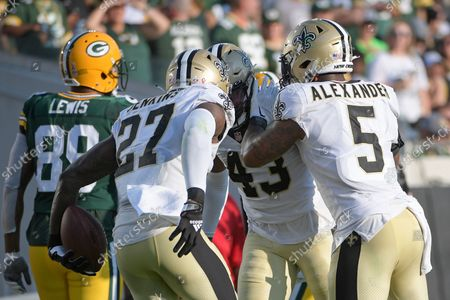New Orleans Saints middle linebacker Kwon Alexander (5) and strong safety Malcolm Jenkins (27) congratulate free safety Marcus Williams (43) after he intercepted a pass against the Green Bay Packers during the second half of an NFL football game, in Jacksonville, Fla
