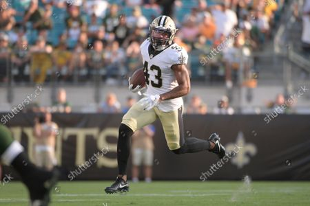New Orleans Saints free safety Marcus Williams (43) runs against the Green Bay Packers after an interception during the second half of an NFL football game, in Jacksonville, Fla