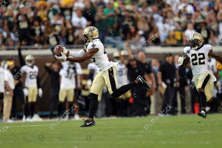 New Orleans Saints free safety Marcus Williams (43) intercepts the ball during an NFL football game against the Green Bay Packers, in Jacksonville