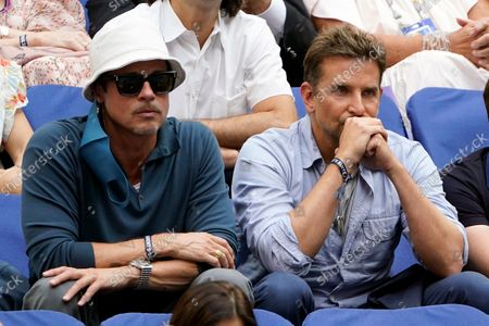 Brad Pitt, left, and Bradley Cooper watch play between Novak Djokovic, of Serbia, and Daniil Medvedev, of Russia, during the men's singles final of the US Open tennis championships, in New York