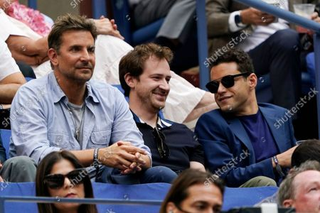 Bradley Cooper, left, Joseph Mazzello, center, and Rami Malek watch play between Novak Djokovic, of Serbia, and Daniil Medvedev, of Russia, during the men's singles final of the US Open tennis championships, in New York