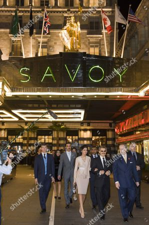 Prince Al-Waleed bin Talal and his wife Princess Amira of Saudi Arabia, General Manager of The Savoy Kiaran MacDonald