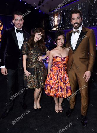 Drew Scott, from left, Zooey Deschanel, Linda Phan, and Jonathan Scott attend the second ceremony of the Television Academy's 2021 Creative Arts Emmy Awards at the L.A. LIVE Event Deck, in Los Angeles
