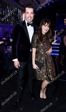 Drew Scott, left, Zooey Deschanel attend the second ceremony of the Television Academy's 2021 Creative Arts Emmy Awards at the L.A. LIVE Event Deck, in Los Angeles